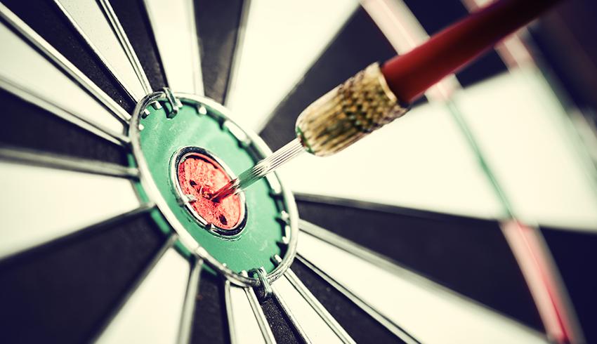 dart in the dartboard's bullseye
