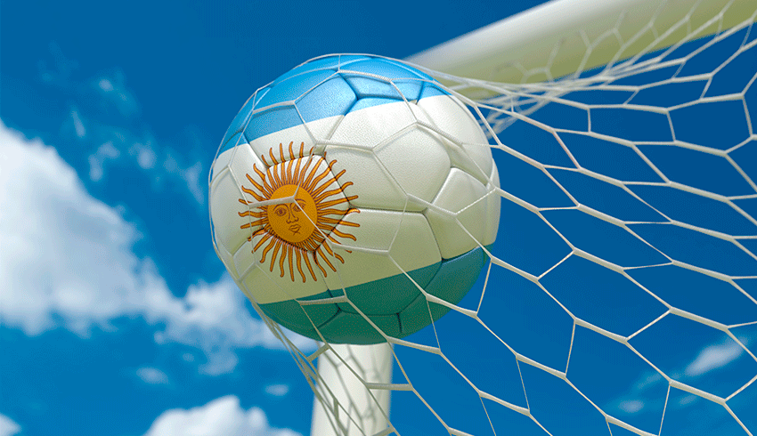 Foot ball with Argentina flag pattern reaching the net