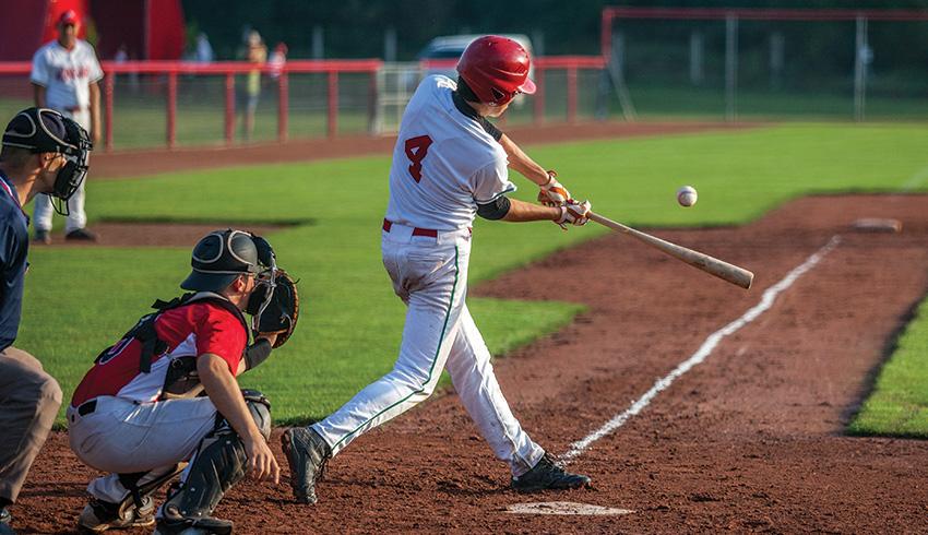 Baseball player hitting the ball during a game
