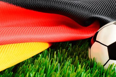 Football and a German flag over the pitch
