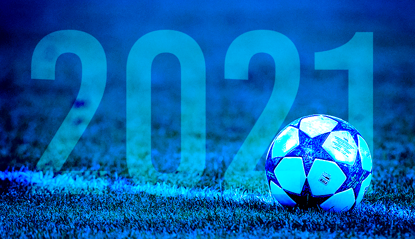 Football on the pitch with 2021 in bold