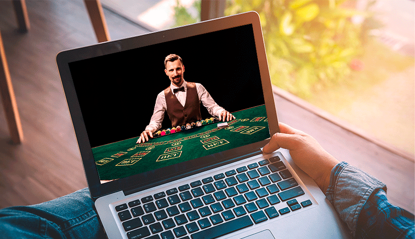 guy playing live casino games on his laptop computer