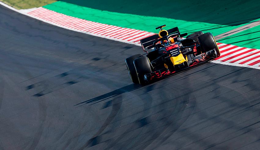 Formula 1 car speeding in the track