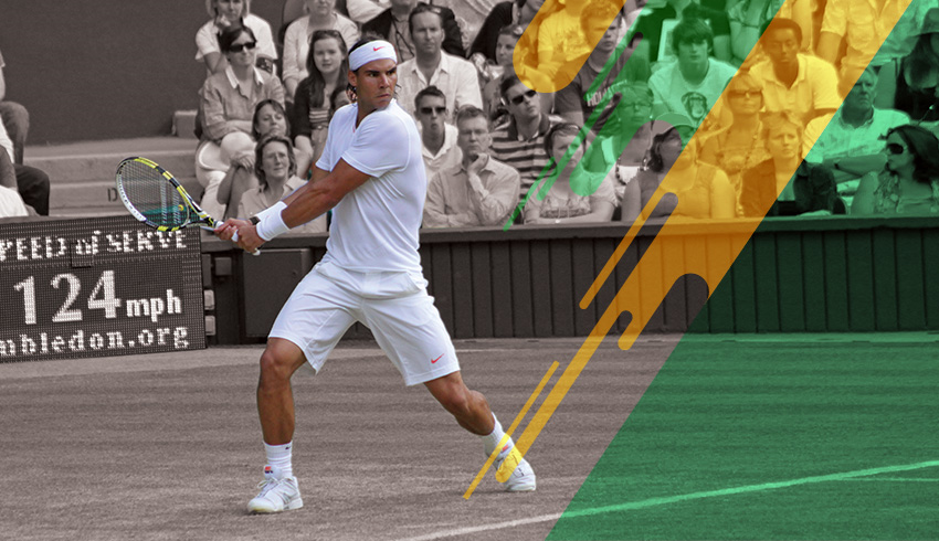 Rafael Nadal preparing to hit the ball during Wimbledon Grand Slam tennis match