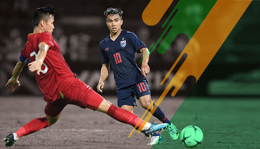 Two international football Asian players disputing Asian World Cup Qualifiers