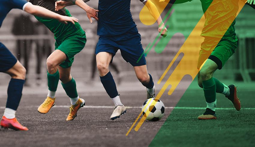 Football players disputing ball during a Brazilian Carioca Série B Championship