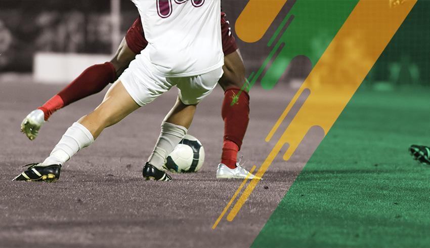 Brazilian players disputing ball during a Cearense Championship match
