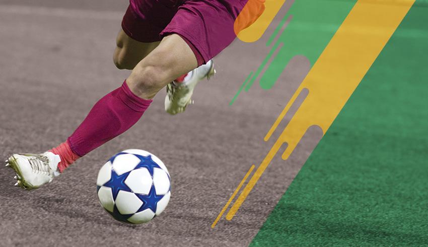 Brazilian Paranaense Championship football players disputing ball during match