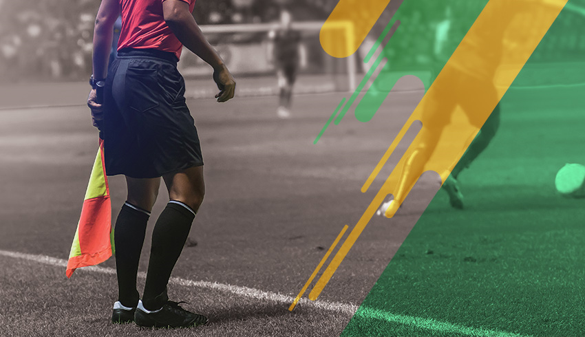 Football players disputing ball during a Brazilian Série B Championship