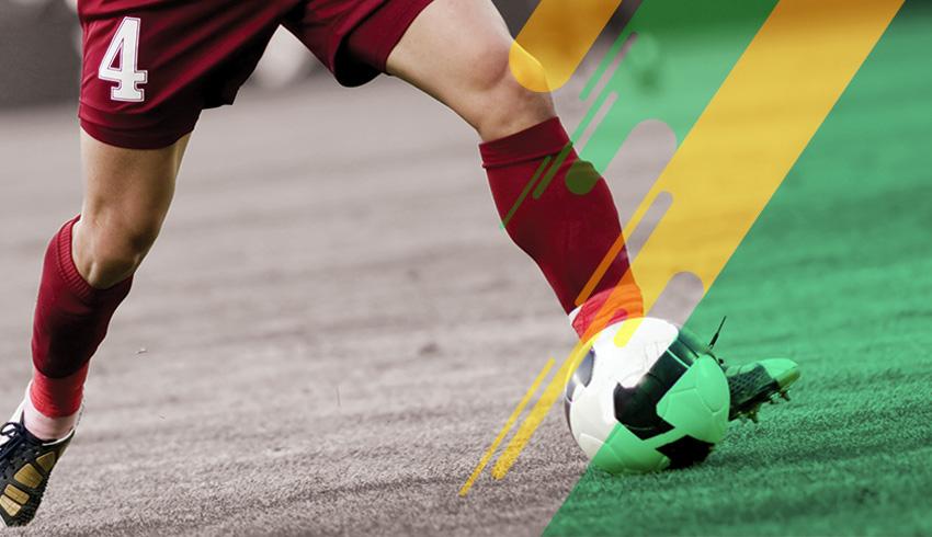 football player dribbling opponent during a Brazilian Copa Verde match