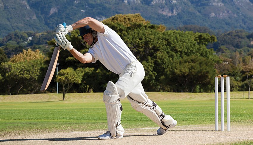 cricket cplayer batting the ball